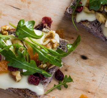 Grilled Cheese Board Sandwich with Brie, Arugula, Honey and Trail Mix
