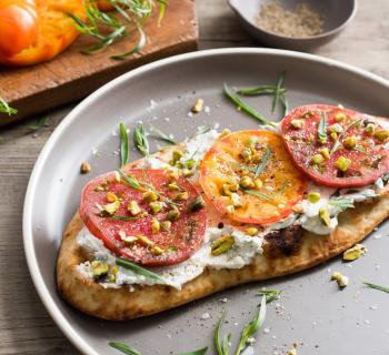 Heirloom Tomato Bruschetta with Fresh Tarragon Ricotta and Pistachios